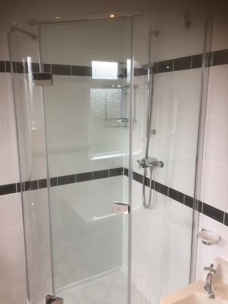 Shower enclosure with a hinged door: Swipe To View More Images